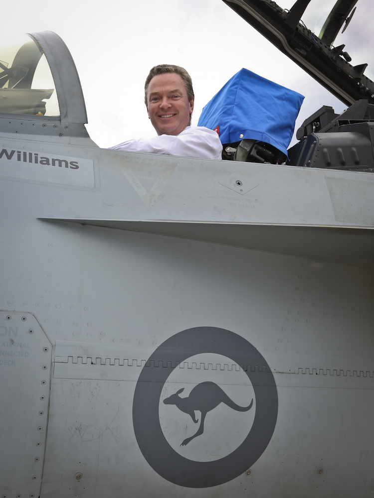 The Honorable Christopher Pyne MP, Minister for Defence Industry sits in the cockpit of an F/A-18F Super Hornet during his visit to RAAF Base Amberley.