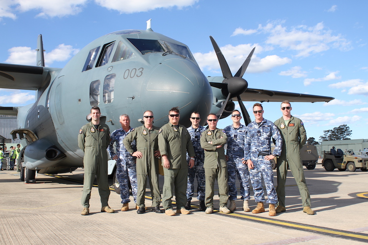 No. 35 Squadron aircrew, technicians and operational support personnel on the flightline with C-27J Spartan A34-003, following the aircraft's arrival at RAAF Base Richmond.