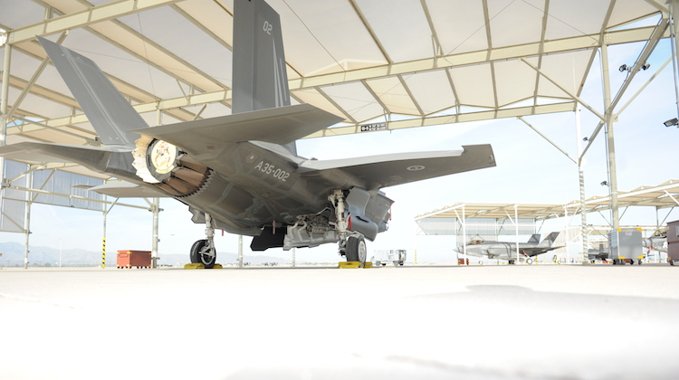 An Australian F-35A Joint Strike Fighter (A35-002) at Luke Air Force Base, Arizona (USA) with its weapons bay open during the loading of the 500lb Paveway II Laser Guided Bomb, the GBU-12, prior to the aircraft's first ever weapons release. The weapons release took place over the Barry M Goldwater Range just west of Luke Air Force Base, Arizona on (insert date) with Australian pilot Squadron Leader Andrew Jackson flying the sortie. A35-002 is one of two Australian F-35A aircraft operating out of the F-35 International Pilot Centre at Luke Air Force Base, Arizona. The Weapons Release marks another significant progress milestone in the Australian F-35A Program.