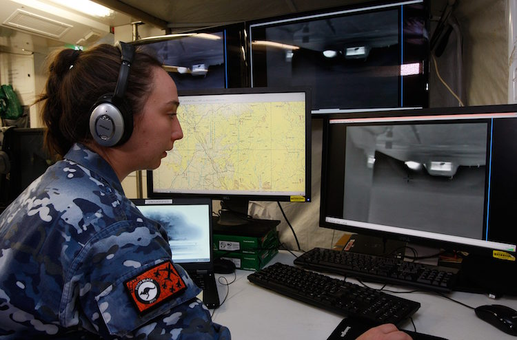 Leading Aircraftwoman Poppy Longmate, an Air Force Geospatial Imagery Analyst, observes live vision from the Heron Remotely Piloted Aircraft during Exercise Pitch Black 2016.