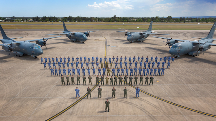 Members of No. 35 Squadron on the flight line with four C-27J Spartan battlefield air lifters at RAAF Base Richmond.