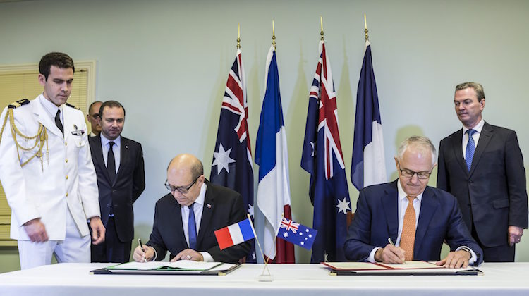 Prime Minister of Australia, the Honourable Malcolm Turnbull and French Minister of Defence, Mr Jean-Yves Le Drian, sign the Framework Agreement between the Government of Australia and the Government of the French Republic Concerning Cooperation on the Future Submarine Program at Keswick Barracks, South Australia.
