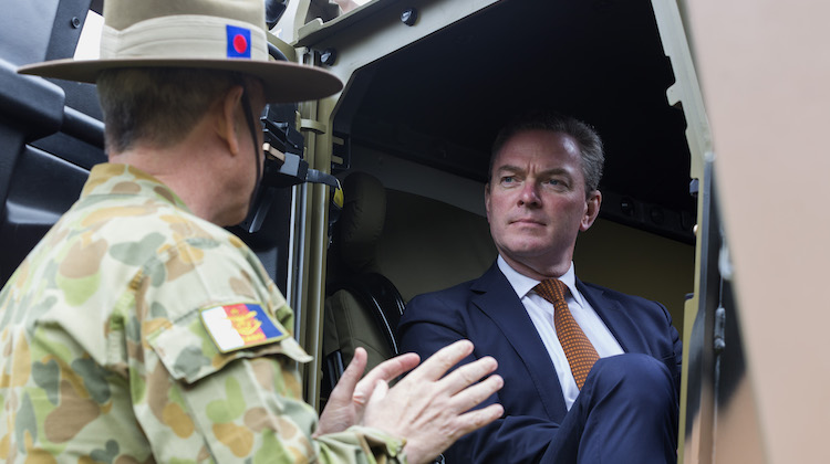 Minister for Defence Industry, the Honourable Christopher Pyne MP is briefed on the Hawkei vehicle by Australian Army officer Lieutenant Colonel Chad Stonier at Victoria Barracks, Melbourne on 14 November 2016.