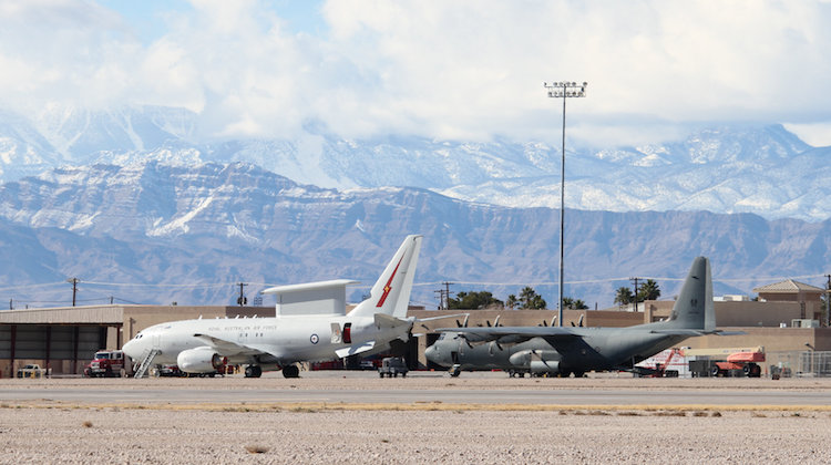 Royal Australian Air Force aircraft, an E-7A Wedgetail (left) and C-130J Hercules on the flightline at Nellis Air Force Base during Exercise Red Flag 17-1.