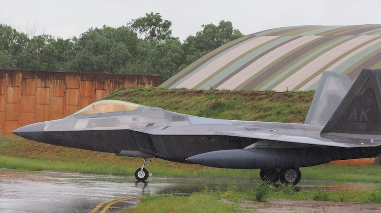 A United States Air Force F-22 aircraft arrives at RAAF Base Tindal under grey skies and rain in the Northern Territory, ahead of the first Enhanced Air Cooperation activity in Australia.