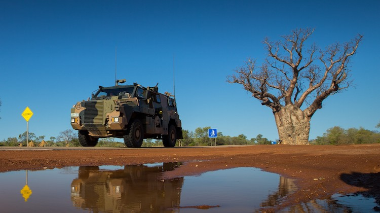 An Australian Army Bushmaster protected mobility vehicle from 1st Brigade drives along the Great Northern Highway during Exercise Northern Shield 2016.