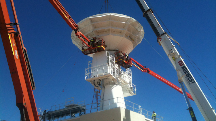 AIR3029 PH1: Hoisting and locking the parabolic antenna into place on the joint Australian/United States C-Band Space Surveillance Radar at Exmouth, Western Australia.