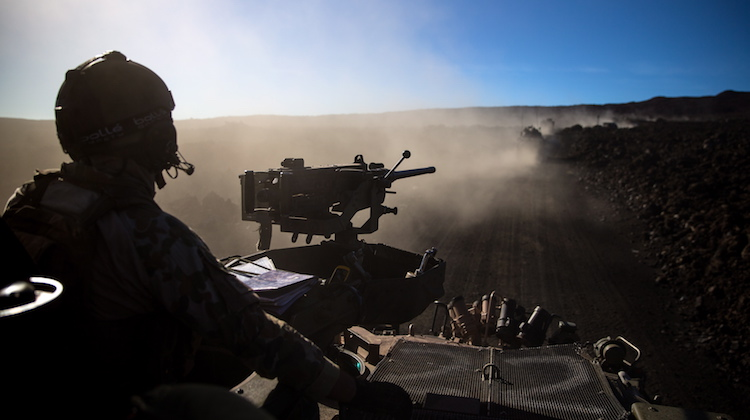 An Australian Army soldier from 2nd Cavalry Regiment ensures his ASLAV (Australian Light-Armoured Vehicles) follows the convoy as it moves through Pohakuloa training area, Hawaii, during Exercise Rim of the Pacific on 17 July 2016.
