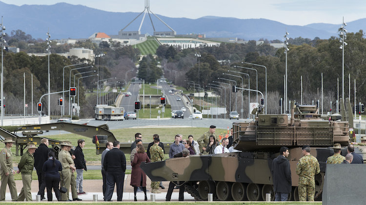 Australian Army soldiers and the public look at an M1A1 Abrams tank during the Army's modernisation showcase at Russell Offices, Canberra, on 29 August 2016.