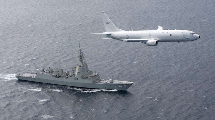 A RAAF P-8A Poseidon supports sea trials for the NUSHIP Hobart in the Gulf St Vincent off the coast of Adelaide.