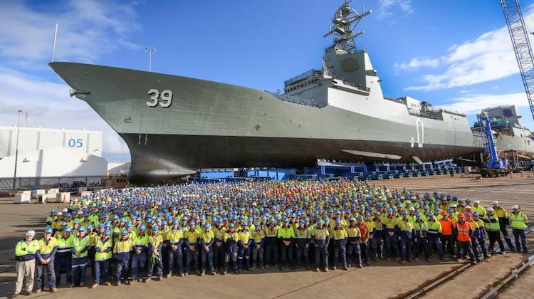 ASC Shipbuilding workers in front of future air warfare destroyer Hobart