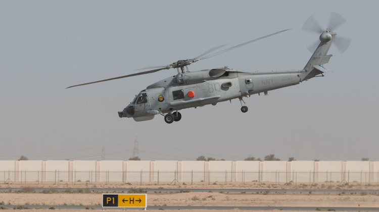 Navy Seahawk Helicopter N24-011 takes off for one last time at Australia's main operating base in the Middle East.