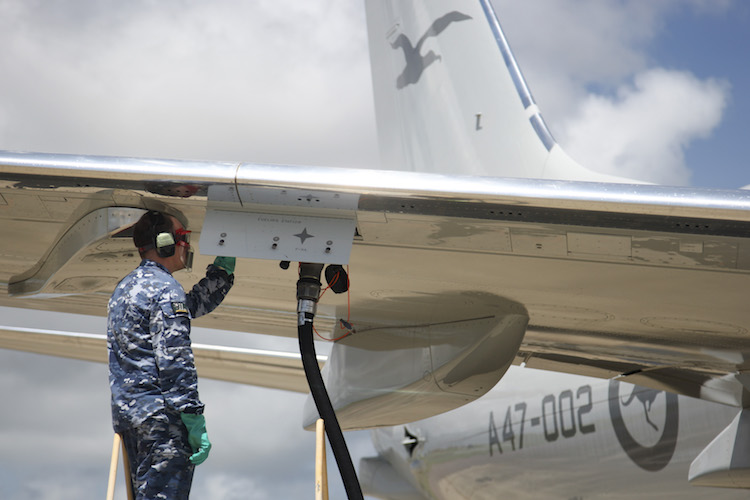 Number 11 Squadron Aircraft Technician Leading Aircraftman Bradley Pascall refuels the P-8A Poseidon at RAAF Base Darwin.