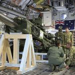 Royal Australian Air Force - Amberley Air Movements personnel work with No. 36 Squadron Loadmasters and Australian Army soldiers from 1 Regiment, Royal Australian Artillery secure an Artillery M777 Howitzer inside a C-17A Globemaster aircraft.