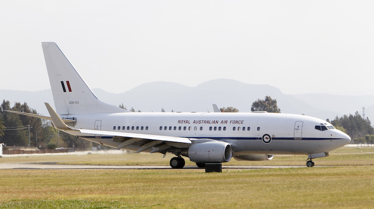 No. 34 Squadron (34SQN) Boeing Business Jet (BBJ) A36-001 taxis off the runway at RAAF Base Richmond. Mid-caption: No. 34 Squadron Royal Australian Air Force (RAAF) has operated a pair of Boeing Business Jets (BBJs) since 2002, with the aircraft routinely utilised by the Australian Government for long distance and international tasking. The range and passenger capacity of the BBJ allows the Australian Government to reach its people across the vast distances of this country, as well as ensuring Australia maintains its place on the world stage during international events, meetings and conferences.