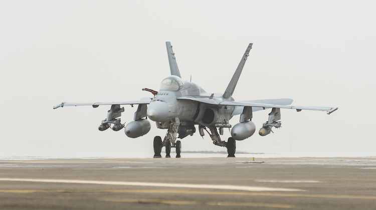 Following an Operation OKRA mission, two Royal Australian Air Force F/A-18A Hornets taxi back into the main air operating base in the Middle East Region.