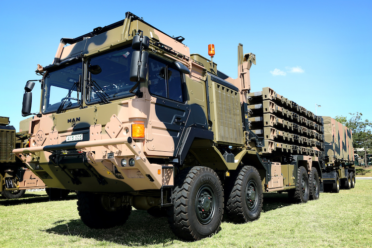 A Rheinmetall MAN integrated load-handling truck with flatracks and integrated load-handling trailer at Wacol, Queensland.