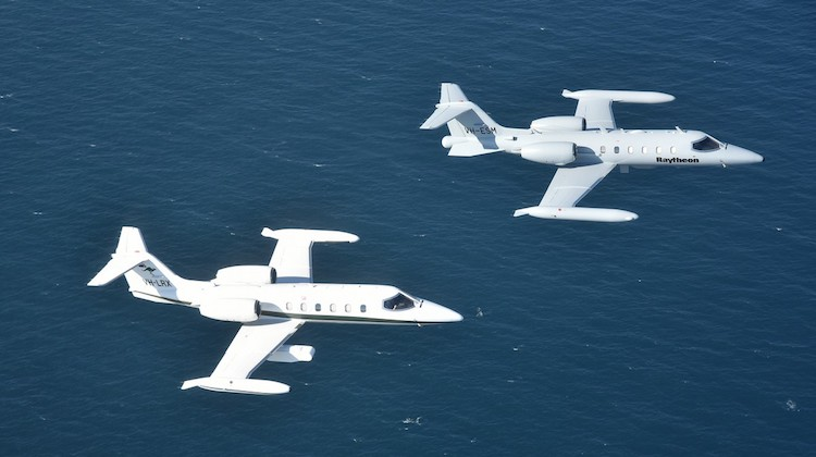 Raytheon Australia and Air Affairs Australia Lear Jets flying in formation