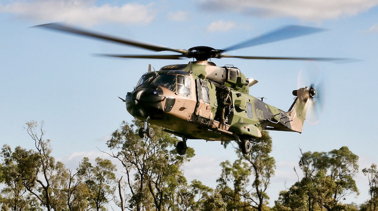 A Multi Role Helicopter (MRH-90) Taipan transports troops during the 3rd Brigade Combined Arms Training Activity (CATA) at the Townsville Field Training Area on 12 June 2014. Comprising nearly 400 personnel, the aviation battlegroup for the CATA consisted of a troop of Armed Reconnaissance Helicopter Tigers from the 1st Aviation Regiment's 161st Squadron, and a troop of MRH-90 Taipans, a troop of S-70A-9 Black Hawks, and a troop of CH-47D Chinooks from each of the 5th Aviation Regiment squadrons.