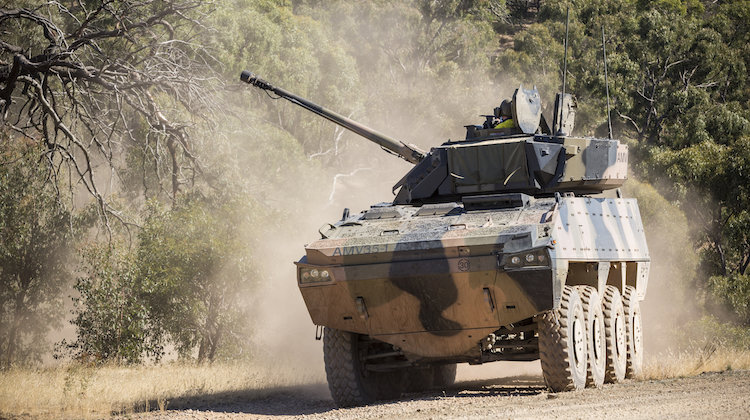 A BAE Systems Australia Patria AMV35 drives through the Armoured Fighting Vehicle Field Firing Training Area at Puckapunyal Range, Victoria, while participating in the Land 400 Risk Mitigation Activity on 22 February 2017.