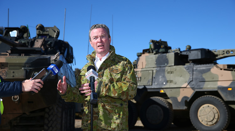 Minister for Defence Industry, Christopher Pyne, conducts press conference in front of BAE Systems Australia Patria AMV35 (left) and Rheinmetall Boxer CRV at Puckapunyal Range, Victoria.