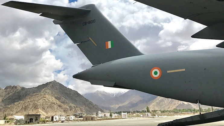 An Indian Air Force (IAF) C-17A Globemaster on the tarmac at Leh Airport, India, during a mission with Royal Australian Air Force (RAAF) C-17A aircrew observing high-altitude airport operations.