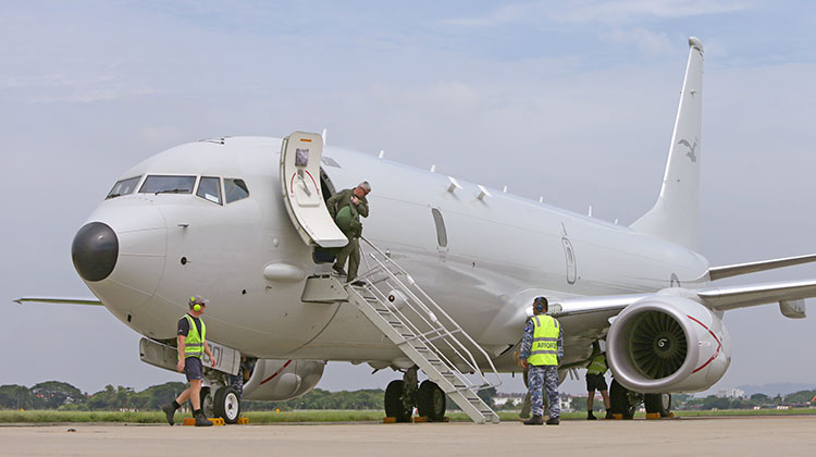 Crew disembarking a P-8A Poseidon at Royal Malaysian Air Force Base Butterworth in support of Operation GATEWAY