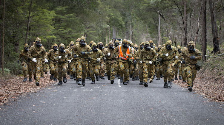 Australian Army soldiers from Task Group Taji Rotation 2 conduct pre-fatigue drills during CBRN (chemical, biological, radiological and nuclear environment) training as part of the task group's training camp at Kokoda Barracks, Canungra, Queensland, in September 2015.