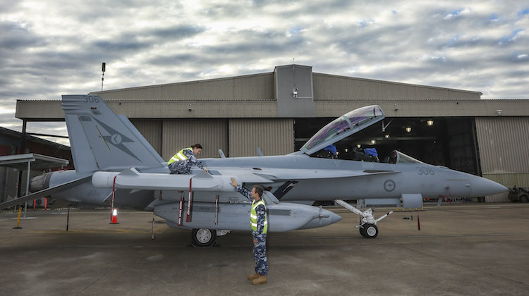 Leading Aircraftwoman Aimee-Rose Carter and Leading Aircraftman Fletcher Moulton perform routine checks on the newly arrived EA-18G Growler at No. 6 Squadron, RAAF Base Amberley.