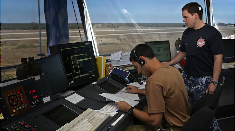 Royal Australian Air Force air traffic controllers, Flying Officer Ebrahim Tabandeh (sitting) and Flight Lieutenant Gavin Cowie, oversee aircraft movements at RAAF base Tindal, Northern Territory, for Exercise Talisman Sabre 2015.