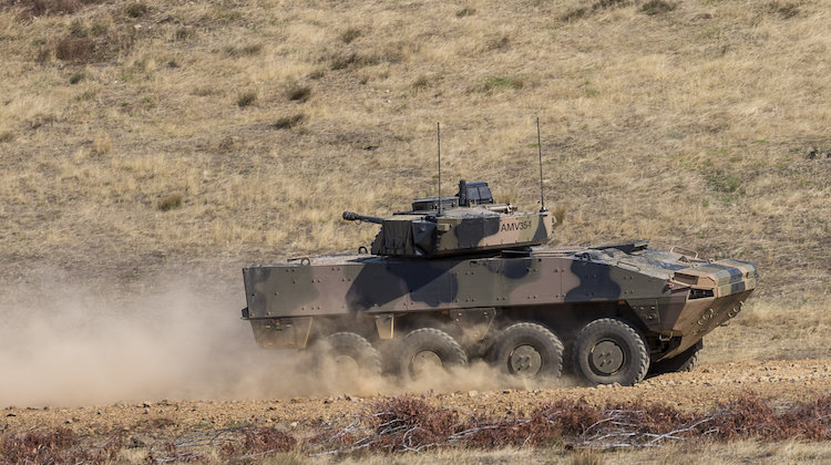 A BAE Systems Australia Patria AMV35 drives off of the Armoured Fighting Vehicle Field Firing Training Area at Puckapunyal Range, Victoria, while participating in the Land 400 Risk Mitigation Activity on 22 February 2017.