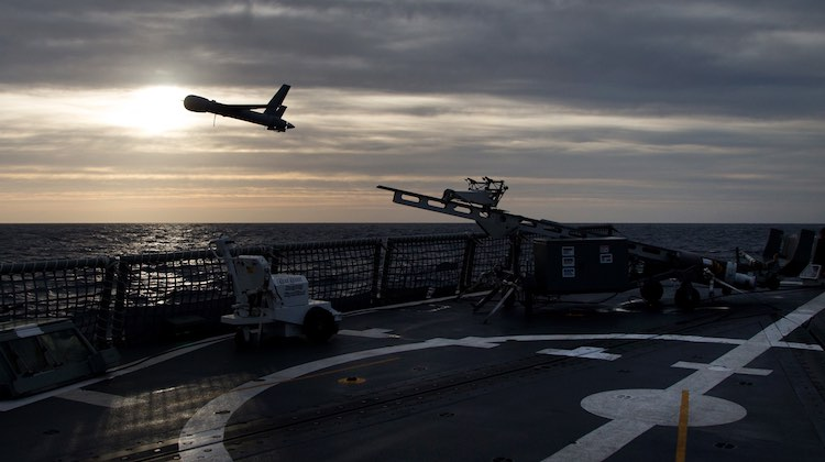 Scan Eagle, an unmmanned aerial vehicle launches from the flight deck of HMAS Newcastle during operational evaluation trials.