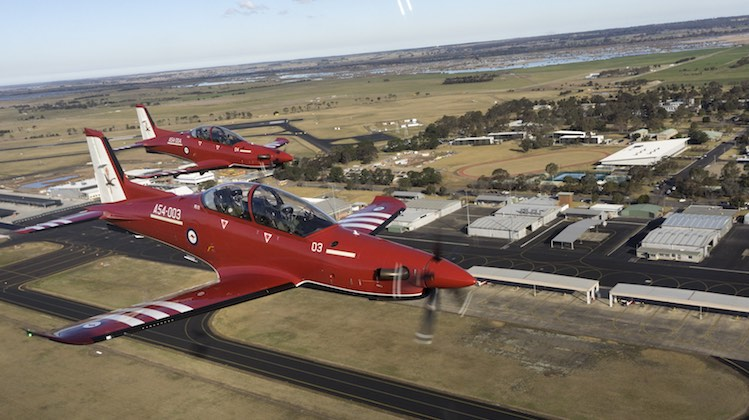Two of Air Force's new Pilatus PC-21 aircraft, A54-003 and A54-004 fly overhead RAAF Base East Sale.