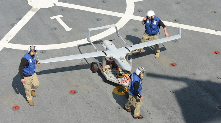 130210-N-NB538-195 GULF OF MEXICO (Feb. 10, 2013) Members of the RQ-21A Small Tactical Unmanned Air System (STUAS) test team transport the RQ-21A across the flight deck of the amphibious transport dock USS Mesa Verde (LPD 19) after its first flight at sea. Mesa Verde is underway conducting exercises. (U.S. Navy photo by Mass Communication Specialist 3rd Class Sabrina Fine/Released)