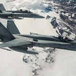 Two Royal Canadian Air Force CF-188 Hornet fighters from 433 Tactical Fighter Squadron fly over Iceland on May 31, 2017 during an Operation REASSURANCE surveillance mission.   Photo: Corporal Gary Calvé. Imagery Technician ATF-ICELAND RP09-2017-0025-005 ~ Deux chasseurs CF-188 Hornet du 433e Escadron d'appui tactique de l'Aviation royale canadienne survolent l'Islande, le 31 mai 2017, lors d'une mission de surveillance au cours de l'opération REASSURANCE.   Photo : Caporal Gary Calvé. Technicien en imagerie, FOA-ISLANDE RP09-2017-0025-005
