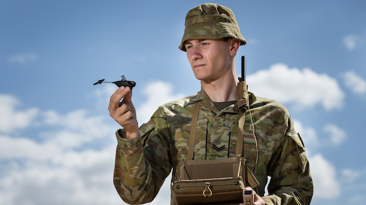 Australian Army soldier Corporal Joshua Collison with a PD-100 Black Hornet miniature unmanned aircraft vehicle at Lavarack Barracks, Townsville, on 17 November 2016.