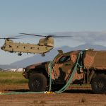 Australian Army CH-47F Chinook hovers into position while conducting external lift trials with the Hawkei Protected Mobility Vehicle.