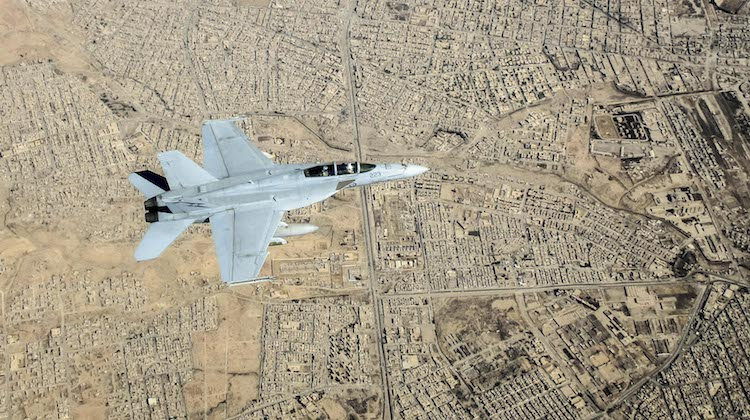 A Royal Australian Air Force F/A-18F Super Hornet flies over Mosul, Iraq, during an Operation OKRA mission.