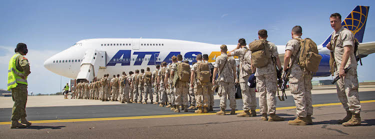 Members of the United States Marine Corps from Marine Rotational Force - Darwin 2017, prepare to board an awaiting aircraft at RAAF Base Darwin, Air Movements Section as they depart Darwin for the final time.