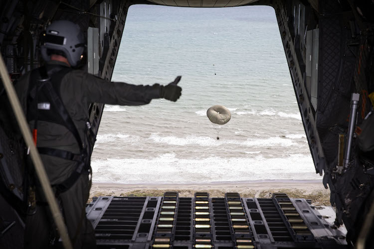 No. 35 Squadron Loadmaster Sergeant Paul Graham gives the all clear as a Container Delivery System descends under parachute during airdrop operations conducted as part of Exercise Southern Katipo 2017.