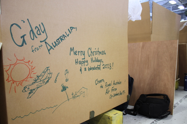 A cardboard container decorated by members of No. 37 Squadron Royal Australian Air Force (RAAF) during the Operation Christmas Drop 17 packing day.