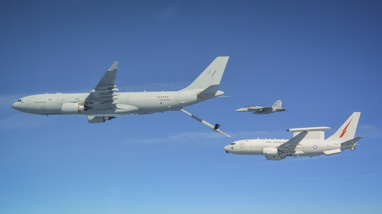 The KC-30A Multi Role Tanker Transport and the E-7A Wedgetail fly in close formation during an air-to-air refuelling serial as part of Operation OKRA while a Royal Australian Air Force F/A-18F Super Hornet formates on the pair. *** Local Caption *** The Air Task Group (ATG) is deployed on Operation OKRA and is operating at the request of the Iraqi Government with a US-led Global Coalition assembled to disrupt and degrade Daesh operations in the Middle East Region (MER). The ATG comprises six RAAF F/A-18F Super Hornet fighter aircraft, an E-7A Wedgetail airborne command and control aircraft, and a KC-30A Multi-Role Tanker Transport aircraft. Additionally, the ATG has personnel working in the Combined Air and Space Operations Centre, and embedded with the 'Kingpin' US tactical command and control unit. The ATG is directly supported by elements of Operation ACCORDION including the Theatre Communications Group, Air Mobility Task Group, and the Expeditionary Airbase Operations Unit. There are up to 300 Australian Defence Force personnel deployed, at any one time, as part of, or in direct support of the ATG.