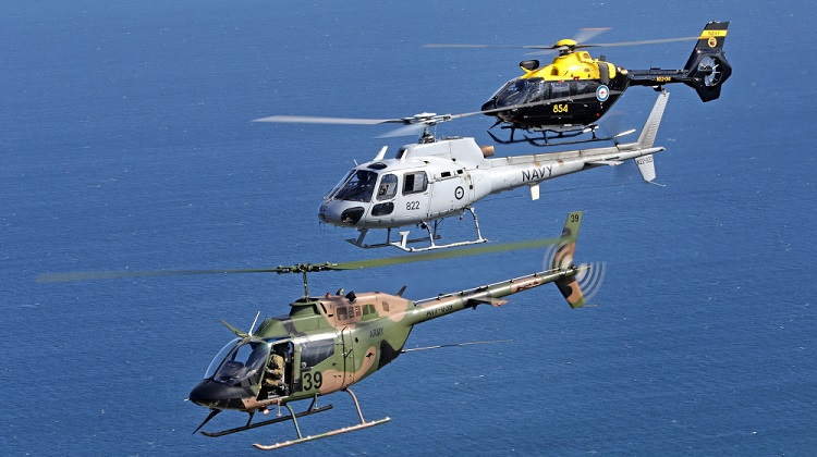 An Australian Army OH-58A Kiowa leads a Royal Australian Navy AS-350BA Squirrel and its replacement a Eurocopter EC-135 over the skies of Nowra, NSW. *** Local Caption *** On Friday 11 December, 2017, HMAS Albatross conducted ceremonial divisions. Divisions were hosted by Commander Australian Fleet, Rear Admiral Stuart Mayer, CSC and Bar, RAN, and reviewed by Chief of Navy Vice Admiral Tim Barrett, AO, CSC, RAN.  The occasion marked the withdrawal from Royal Australian Navy (RAN) Service of the S-70B-2 Seahawk (Bravo) and the AS350BA Squirrel helicopters. Having served all three services of the ADF the Squirrel has accrued more than 179,000 flying hours in its 33 years of service. In the case of Navy the Squirrel has served in both peace and on war and war-like operation becoming affectionately known as the 'Battle Budgie'.  The Seahawk has given the RAN more than 29 years of service accruing in excess of 88,000 flight hours. The 'Bravo' of 816 Squadron has been on continuous operational service since 1990; at total of 27 years and 54 rotations to the Middle East Region.