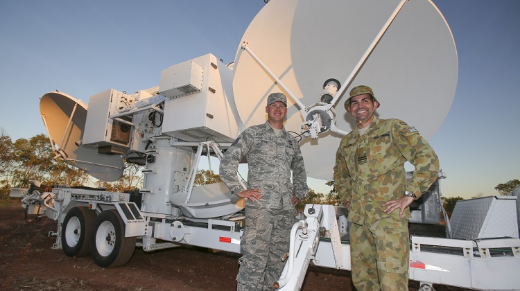 After the safe arrival and positioning of the United States Air Force Joint Threat Emitter at Bradshaw Field Training Area in the Northern Territory, Technical Sergeant Phil Mason and Royal Australian Air Force Flight Lieutenant Matt Rush pause and relax for a moment. *** Local Caption *** Exercise Diamond Storm, run by the Air Warfare Centre, is one of the practical components of the Air Warfare Instructors Course which graduates students who are experts in Australian Defence Force capabilities and integration across the services, and also have technical mastery of their own roles, capabilities and systems.