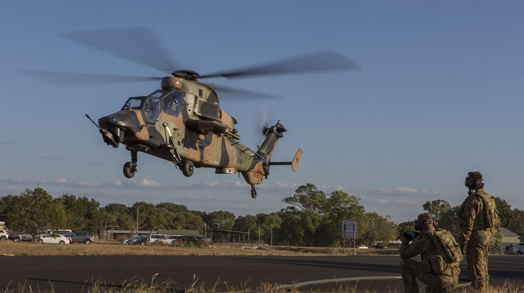 An ARH Tiger helicopter from the 1 Aviation Regiment, Australian Army comes into land at RAAF Base Darwin during Exercise Diamond Storm. *** Local Caption *** Exercise Diamond Storm, run by the Air Warfare Centre, is one of the practical components of the Air Warfare Centre Instructors Course which graduates students who are experts in Australian Defence Force capabilities and integration across the services, and also have technical mastery of their own roles, capabilities and systems.