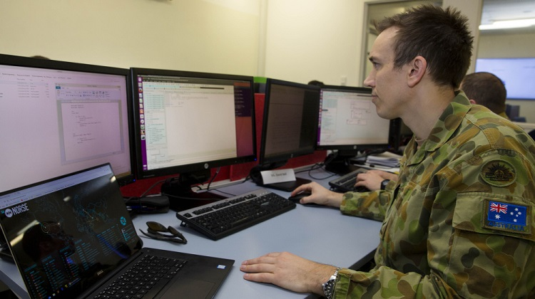 Lance Corporal Anthony Neale, of the Defence Force School of Signals, studies cyber defence operations while attending the University of New South Wales Canberra Cyber Operations course run by the Australian Centre for Cyber Security at Australian Defence Force Academy in Canberra. *** Local Caption *** With cyber security moving to the peak of global political and defence agendas as well as recent front-page news, advanced training is continuing for personnel who will work in Army's new cyber security roles. A group of Army members are attending the University of New South Wales Canberra cyber operations courses run by the Australian Centre for Cyber Security at Australian Defence Force Academy, which began on 12 September and will finish on 23 November, 2017. Coming from varied corps, the students challenged themselves during the all-rank course in subjects covering passive and active cyber defence operations. The course will assist soldiers to incorporate cyberspace considerations into planning and operations while reinforcing the importance of security and defensive measures.