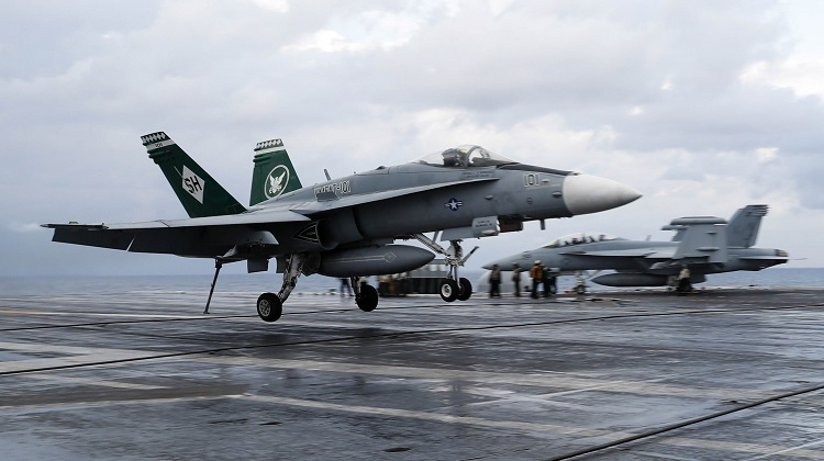 180317-N-FK070-0120 ATLANTIC OCEAN (March 17, 2018) Finnish Air Force Capt. Juha Jarvinen lands an F/A-18C Hornet assigned to the Sharpshooters of Marine Strike Fighter Training Squadron (VMFAT) 101 on the flight deck of the Nimitz-class aircraft carrier USS Abraham Lincoln (CVN 72). This marks the first time a Finnish pilot has performed an arrested landing aboard an aircraft carrier. (U.S. Navy photo by Mass Communication Specialist 1st Class Brian M. Wilbur/Released)