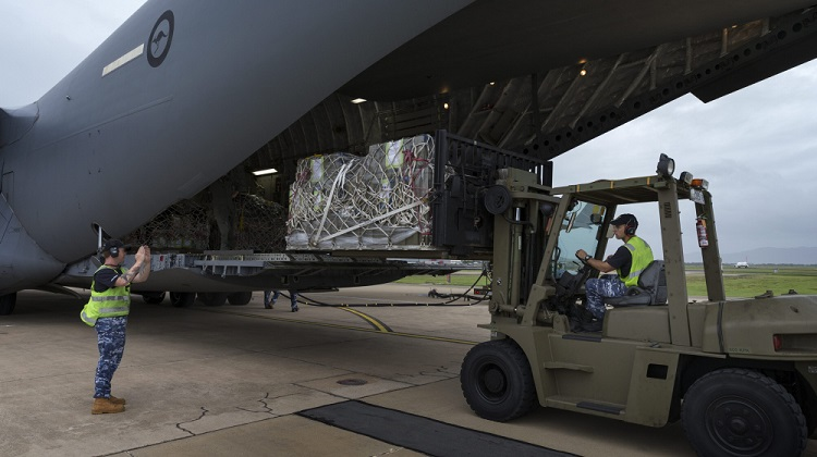 Members of the Royal Australian Air Force Air Load Team lift supplies and support equipment, destined for Operation PNG Assist 2018, onto a C-17A Globemaster at RAAF Base Townsville. *** Local Caption *** At the request of the Government of Papua New Guinea (PNG), the Australian Defence Force is providing support to the Department of Foreign Affairs effort following the 7.5 magnitude earthquake that struck central PNG on 26 February 2018. Operation PNG Assist 2018 is the ADF contribution to the DFAT led Whole of Australian Government response to the recent earthquake. C-130J Hercules aircraft, from Royal Australian Aircraft Base Richmond, have made multiple flights to affected areas with ADF personnel to support the Government of PNG in transporting personnel and supplies to the Hela and Southern Highlands provinces. RAAF C-17A Globemasters have begun ferrying ADF personnel and equipment to PNG.  Three Australian Army CH-47 Chinook aircraft from Townsville have arrived at Mount Hargen to deliver aid and supplies to outlying regions.