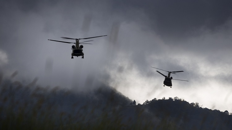 Two Australian Army CH-47F Chinook helicopters depart from Mount Hagen Airport during Operation PNG Assist 2018. *** Local Caption *** Three Australian Army CH-47F Chinook aircraft from Townsville based 5th Aviation Regiment have begun ferrying essential supplies to remote areas of Papua New Guinea affected by a 7.5 magnitude earthquake which struck on 26 February 2018. Operation PNG Assist 2018 is the ADF contribution to the DFAT led, Whole of Australian-Government response to the earthquake. The Boeing CH-47F Chinook is the largest helicopter in the Australian Army, and is one of the most versatile.