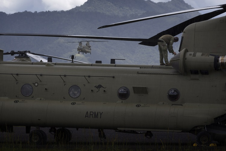 An Australian Army CH-47F Chinook helicopter returns to Mount Hagen Airport during Operation PNG Assist 2018. *** Local Caption *** Three Australian Army CH-47F Chinook aircraft from Townsville based 5th Aviation Regiment have begun ferrying essential supplies to remote areas of Papua New Guinea affected by a 7.5 magnitude earthquake which struck on 26 February 2018. Operation PNG Assist 2018 is the ADF contribution to the DFAT led, Whole of Australian-Government response to the earthquake. The Boeing CH-47F Chinook is the largest helicopter in the Australian Army, and is one of the most versatile.